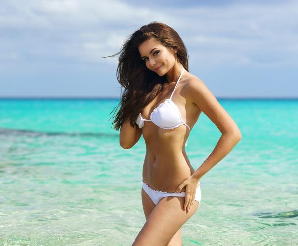 woman in swimsuit posing showing figure