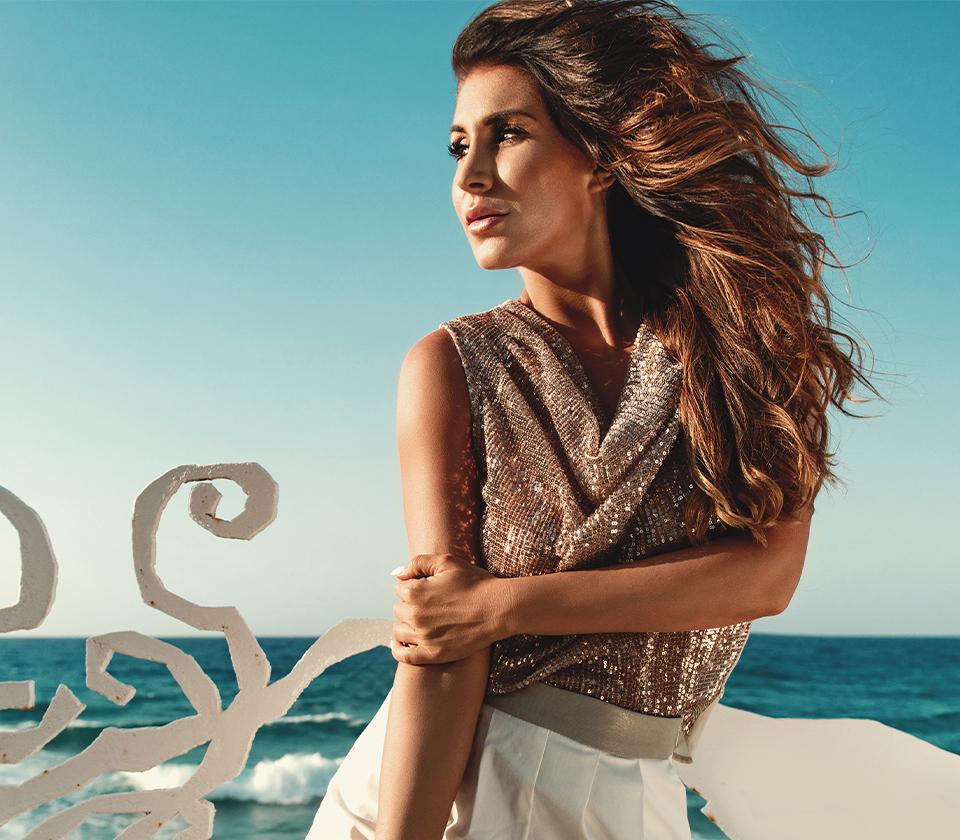 woman posing in front of ocean